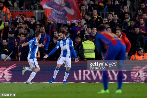 Leganes' midfielder Unai Lopez celebrates his goal with Leganes' defender Alberto Martin during the Spanish league football match FC Barcelona vs CD...