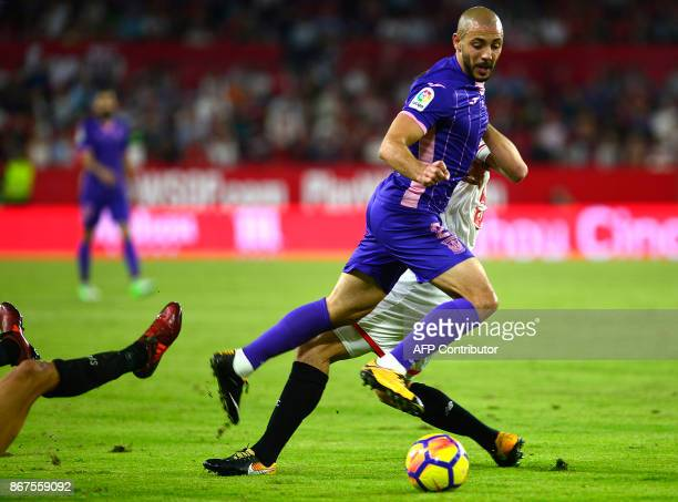 Leganes' Moroccan forward Nordin Amrabat with Sevilla's French defender Clement Lenglet during the Spanish league footbal match Sevilla FC vs Club...