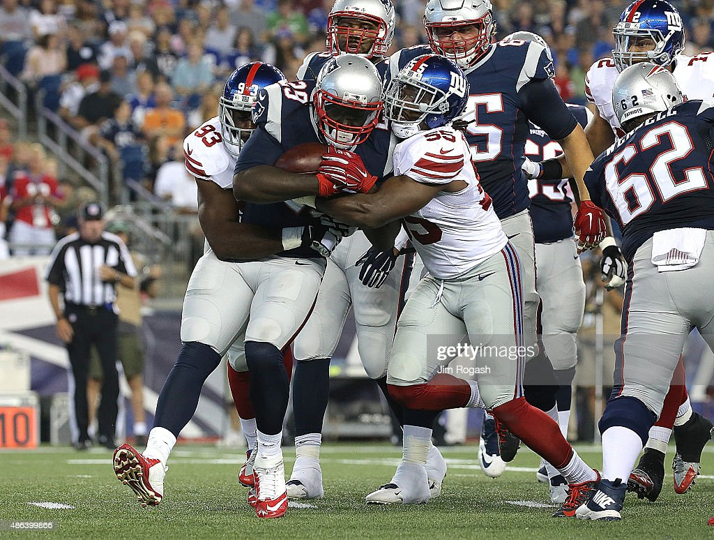 <a gi-track='captionPersonalityLinkClicked' href=/galleries/search?phrase=LeGarrette+Blount&family=editorial&specificpeople=5622855 ng-click='$event.stopPropagation()'>LeGarrette Blount</a> #29 of the New England Patriots is stopped by <a gi-track='captionPersonalityLinkClicked' href=/galleries/search?phrase=J.T.+Thomas+-+American+Football+Linebacker+-+Born+1988&family=editorial&specificpeople=11515262 ng-click='$event.stopPropagation()'>J.T. Thomas</a> #55 and <a gi-track='captionPersonalityLinkClicked' href=/galleries/search?phrase=George+Selvie&family=editorial&specificpeople=4483733 ng-click='$event.stopPropagation()'>George Selvie</a> #93 of the New York Giants in the first quarter at Gillette Stadium on September 3, 2015 in Foxboro, Massachusetts.