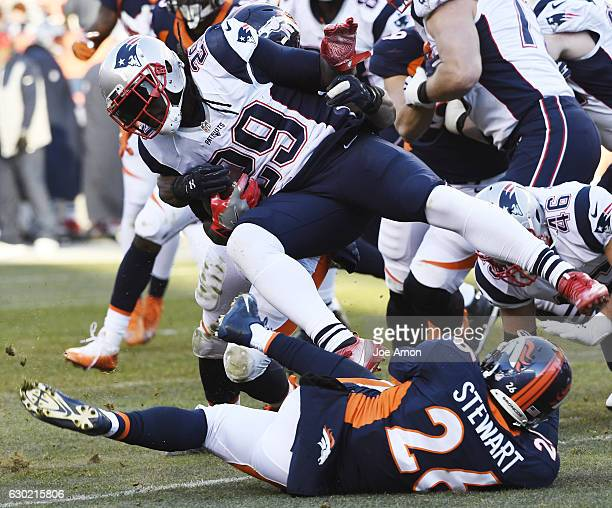 LeGarrette Blount of the New England Patriots is tackled by Corey Nelson of the Denver Broncos and Darian Stewart during the second quarter on Sunday...
