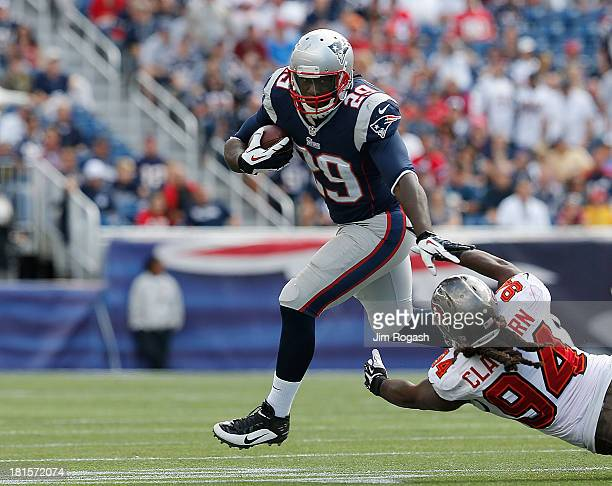 LeGarrette Blount of the New England Patriots leaps over Adrian Clayborn of the Tampa Bay Buccaneers in the second half of a game at Gillette Stadium...
