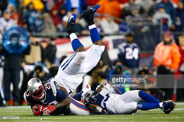 LeGarrette Blount of the New England Patriots runs with the ball against Arthur Jones and Mike Adams of the Indianapolis Colts in the first half of...