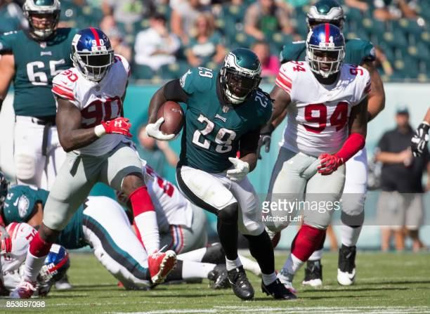 LeGarrette Blount of the Philadelphia Eagles runs the ball against Jason PierrePaul and Dalvin Tomlinson of the New York Giants in the third quarter...