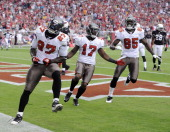 LeGarrette Blount of the Tampa Bay Buccaneers celebrates his touchdown with Arrelious Benn and Maurice Stovall for a 3114 lead over the Arizona...
