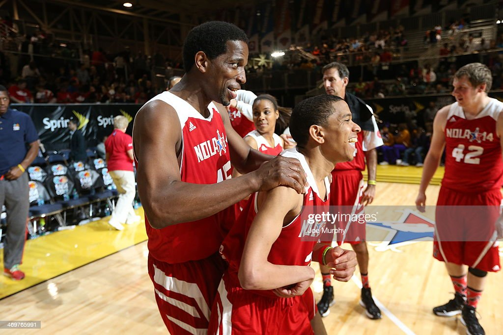 NBA Legend A.C. Green of the West Team celebrates with his team mate during the NBA Cares Special Olympics Unified Sports Basketball Game at Sprint Arena during the 2014 NBA All-Star Jam Session at the Ernest N. Morial Convention Center on February 16, 2014 in New Orleans, Louisiana.