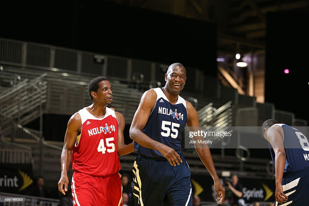 NBA Legend A.C. Green of the West Team shares a laugh with NBA Legend Dikembe Mutombo of the East Team during the NBA Cares Special Olympics Unified Sports Basketball Game at Sprint Arena during the 2014 NBA All-Star Jam Session at the Ernest N. Morial Convention Center on February 16, 2014 in New Orleans, Louisiana.