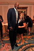 Legend and former NBA player James Worthy and gymnast Shawn Johnson attend the 28th Annual Great Sports Legends Dinner to Benefit The Buoniconti Fund...
