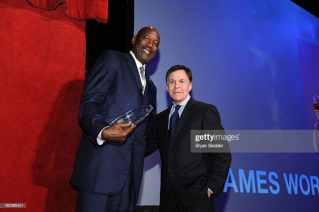Legend and former NBA player James Worthy and sportscaster Bob Costas appear on stage at the 28th Annual Great Sports Legends Dinner to Benefit The...