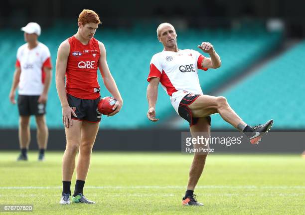Legend and Sydney Swans Goalkicking coach Tony Lockett speaks to Toby Pink of the Swans during a Sydney Swans AFL training session at Sydney Cricket...