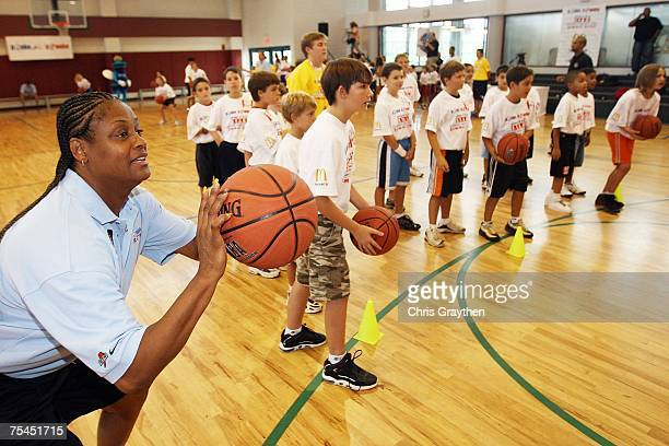 Legend Andrea Stinson works with campers at the unveiling of the New Orleans AllStar logo at the Jr NBA/Jr WNBA Basketball Camp on July 17 2007 at...