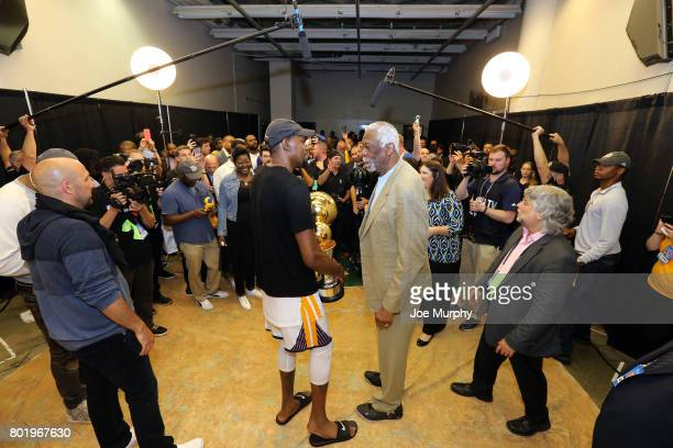 Legend Bill Russell and Kevin Durant of the Golden State Warriors pose for a photo with the Larry O'Brien Trophy and the Bill Russell Finals MVP...