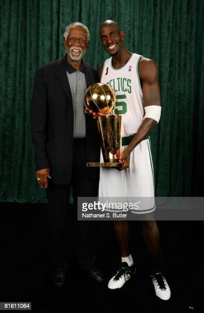 Legend Bill Russell and Kevin Garnett of the Boston Celtics pose for a portrait with the Larry O'Brien trophy after defeating the Los Angeles Lakers...