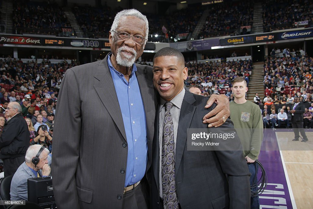 NBA legend Bill Russell and Sacramento Mayor Kevin Johnson greet each other before the Dallas Mavericks game against the Sacramento Kings on February...
