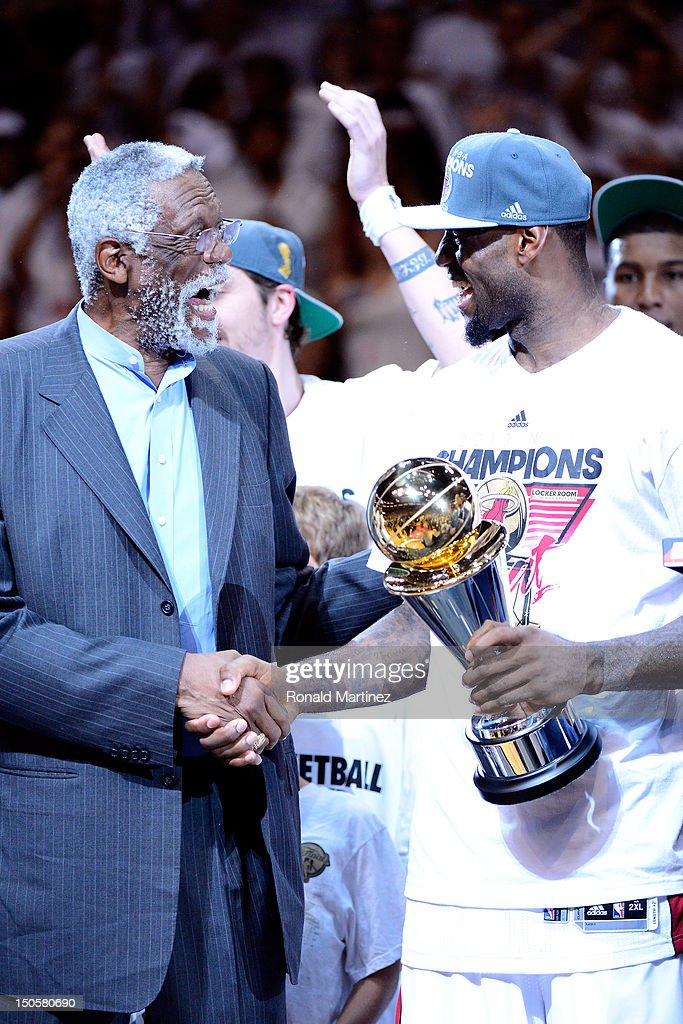 NBA Legend Bill Russell presents LeBron James #6 of the Miami Heat with the Bull Russell NBA Finals MVP trophy after James was named NVP following their 121-106 win against the Oklahoma City Thunder in Game Five of the 2012 NBA Finals on June 21, 2012 at American Airlines Arena in Miami, Florida.