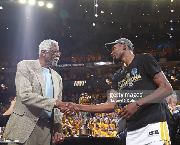 Legend Bill Russell shakes hands with Kevin Durant of the Golden State Warriors after winning the Finals MVP after Game Five of the 2017 NBA Finals...