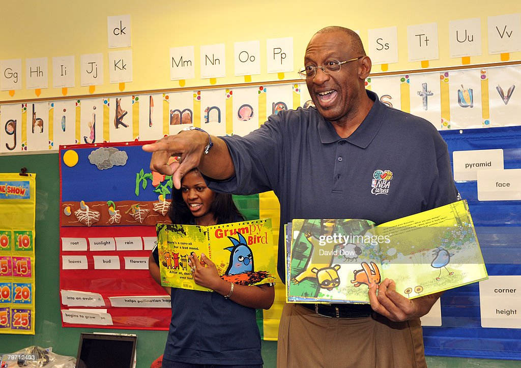 Legend Bob Lanier speaks with children from Martin Behrman Charter School at the NBA Cares Read to Achieve event during AllStar Week on February 11...