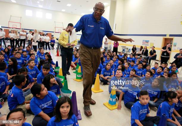 NBA legend Bob Lanier talks with students at Victor Fields Elementary School before the start of a BBVA Compass/WNBA Cares event in McAllen Texas...