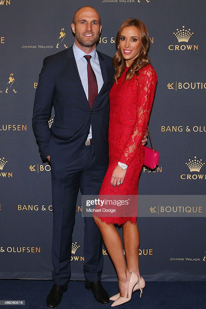 AFL legend Chris Judd and wife Rebecca Judd pose ahead of Crown's inaugural Father's Day luncheon at Crown Entertainment Complex on September 3, 2015 in Melbourne, Australia.