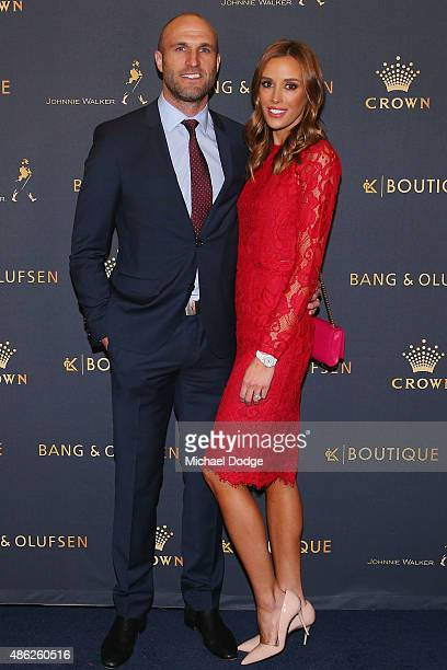 AFL legend Chris Judd and wife Rebecca Judd pose ahead of Crown's inaugural Father's Day luncheon at Crown Entertainment Complex on September 3 2015...