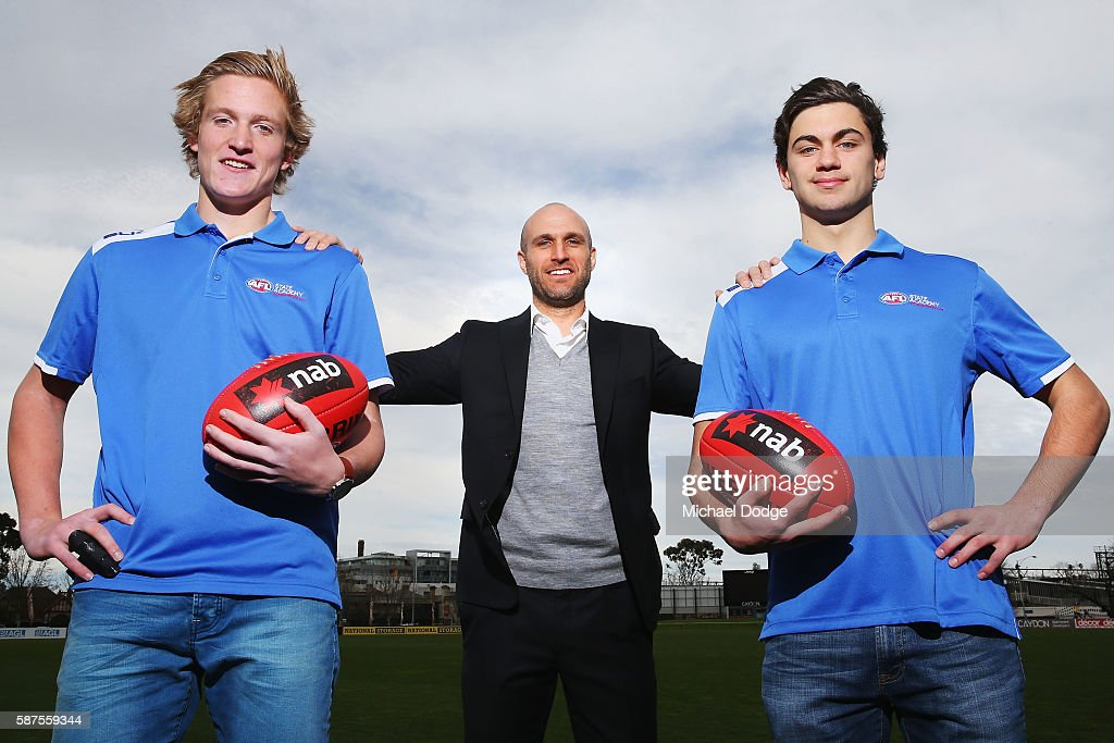 AFL Legend Chris Judd (C) poses with Patrick Kerr (Oakleigh Changers and Vic Metro) and Tim Taranto (R) (Sandringham Dragons and Vic Metro) during the 2016 AFL NAB All Stars matches announcement at Punt Road Oval on August 9, 2016 in Melbourne, Australia.