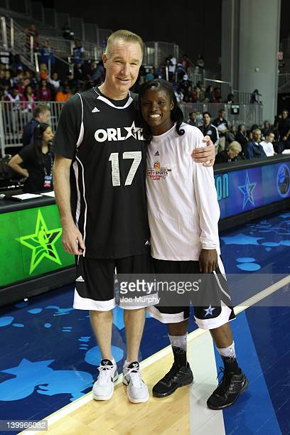 Legend Chris Mullin and Marie FerdinandHarris of the Phoenix Mercury pose for a photo before the NBA Cares/Special Olympics Unity Sports Basketball...