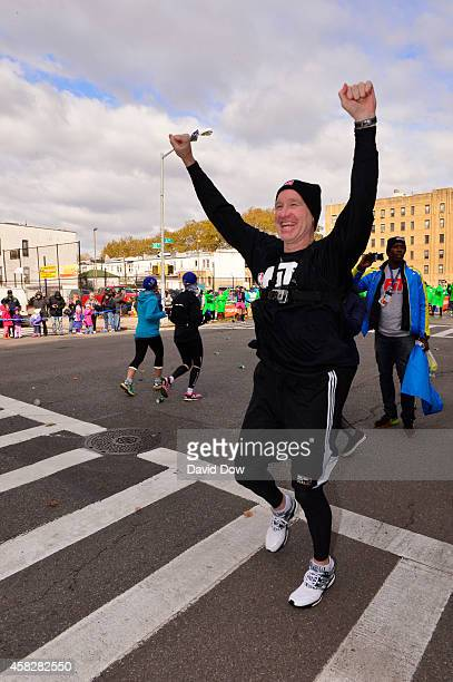 Legend Chris Mullin cheers prior to running his leg in the 2014 NBA AllStar Relay during the TCS NYC Marathon on November 2 2014 in New York City...