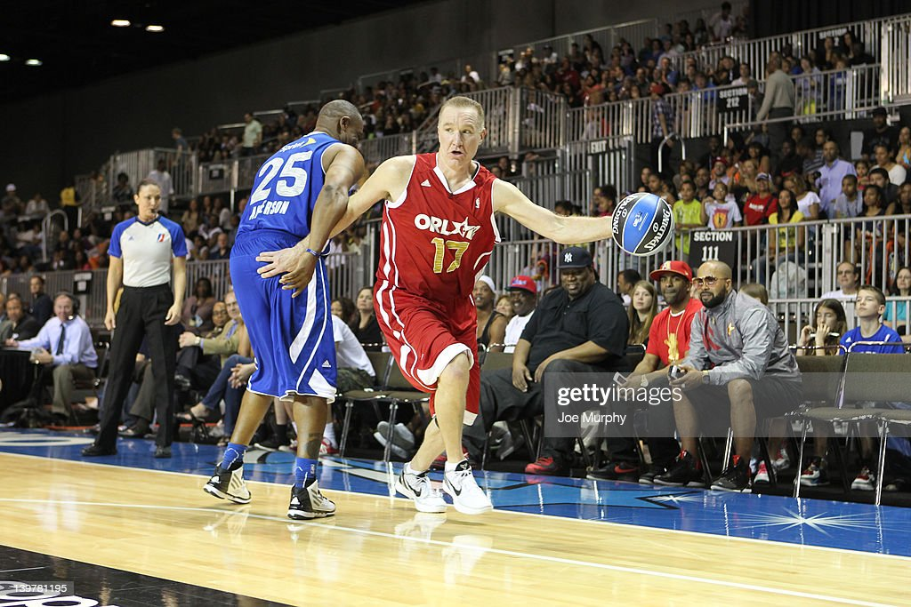 NBA Legend <a gi-track='captionPersonalityLinkClicked' href=/galleries/search?phrase=Chris+Mullin&family=editorial&specificpeople=206816 ng-click='$event.stopPropagation()'>Chris Mullin</a> of the West team drives the ball against NBA Legend <a gi-track='captionPersonalityLinkClicked' href=/galleries/search?phrase=Nick+Anderson&family=editorial&specificpeople=512840 ng-click='$event.stopPropagation()'>Nick Anderson</a> of the East team during the Sprint All-Star Celebrity Game on center court at Jam Session during the NBA All-Star Weekend on February 24, 2012 at the Orange County Convention Center in Orlando, Florida.