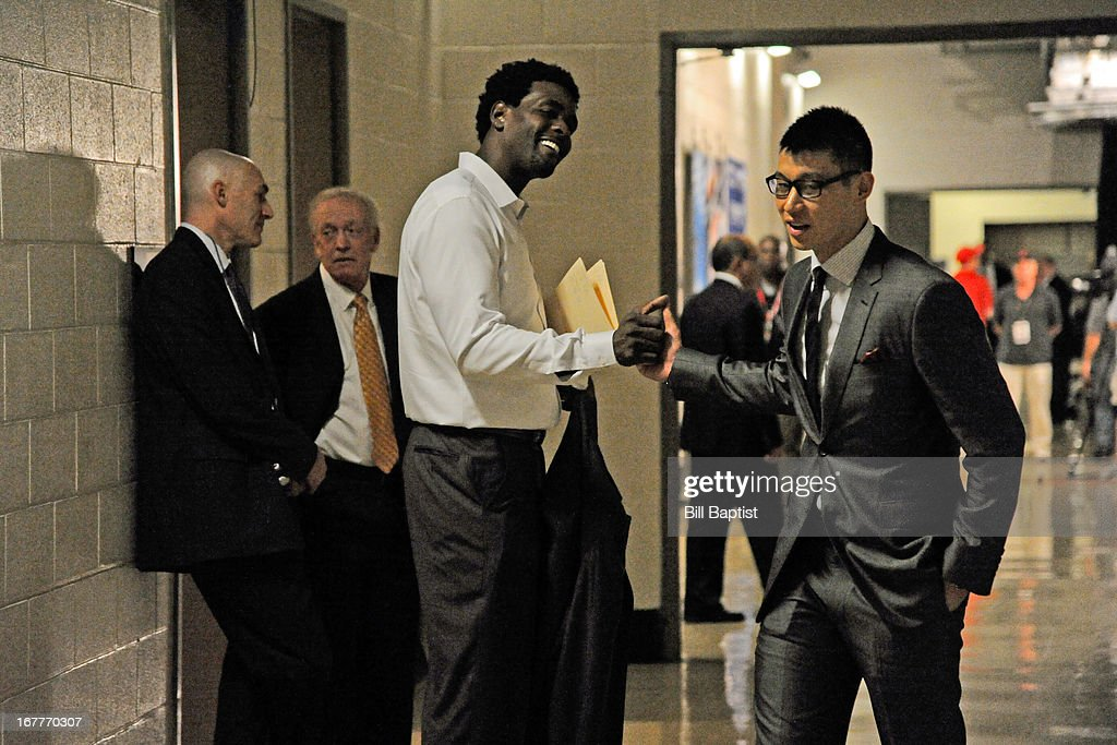 Legend Chris Webber greets Jeremy Lin #7 of the Houston Rockets as he arrives to play against the Oklahoma City Thunder in Game Four of the Western Conference Quarterfinals during the 2013 NBA Playoffs on April 29, 2013 at the Toyota Center in Houston, Texas.