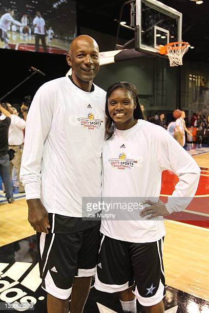 Legend Clyde Drexler and Marie FerdinandHarris of the Phoenix Mercury pose for a photo before the NBA Cares/Special Olympics Unity Sports Basketball...
