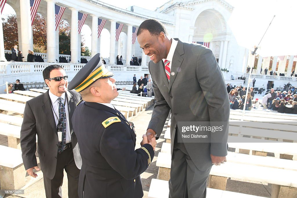 NBA legend David Robinson greets a serving military member during Veterans Day ceremonies at Arlington National Cemetery on November 11, 2013 in Washington, DC.