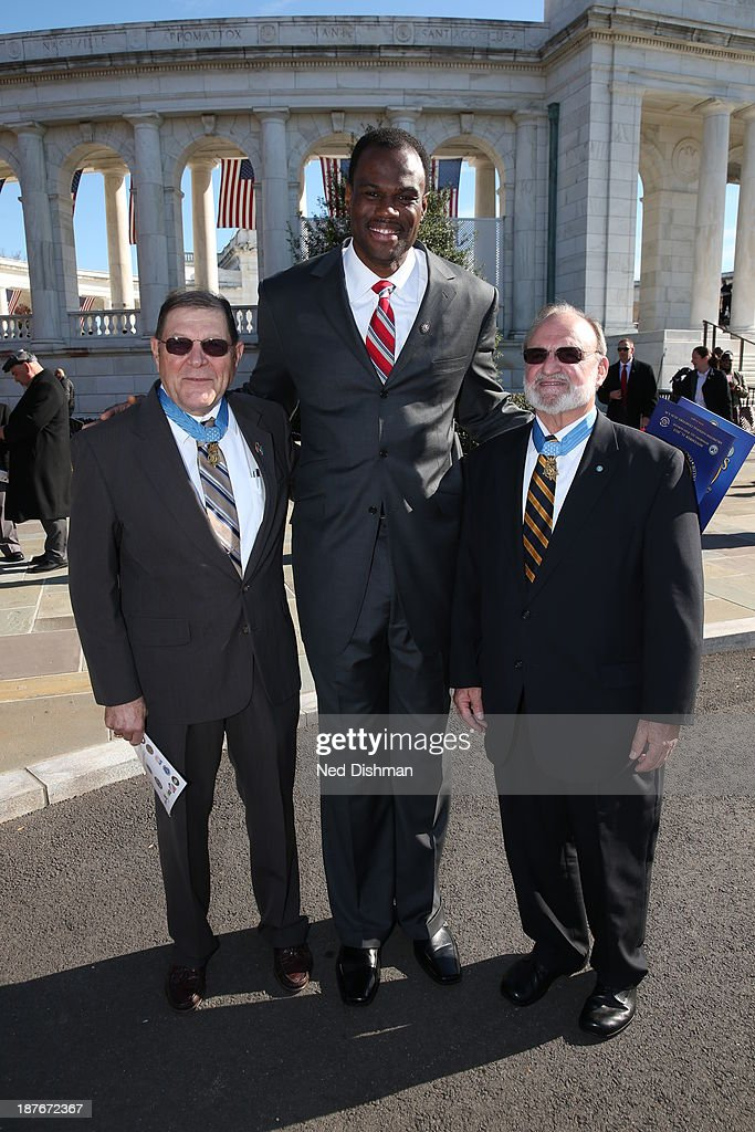 NBA legend David Robinson takes a photo with two Medal of Honor recipients during Veterans Day ceremonies at Arlington National Cemetery on November 11, 2013 in Washington, DC.