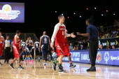 Legend Detlef Schrempf highfives Tim Hardaway Jr of the New York Knicks Coach of the West Team during the NBA Cares Special Olympics Unified Sports...