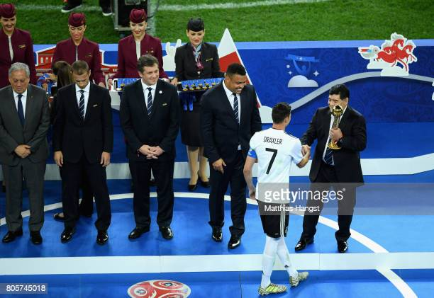 FIFA legend Diego Maradona awards Julian Draxler of Germany the golden ball award during the FIFA Confederations Cup Russia 2017 Final between Chile...