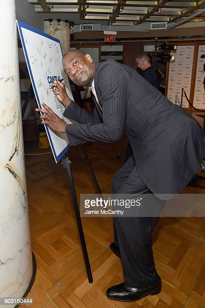 Legend Dikembe Mutombo attends the Annual Charity Day hosted by Cantor Fitzgerald BGC and GFI at Cantor Fitzgerald on September 12 2016 in New York...
