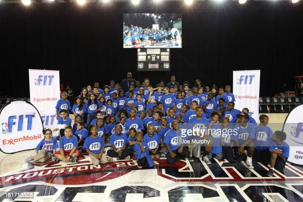 Legend Dikembe Mutombo James White of the New York Knicks and Swin Cash of the Chicago Sky pose with young fans during the Opening Ceremony / NBA...
