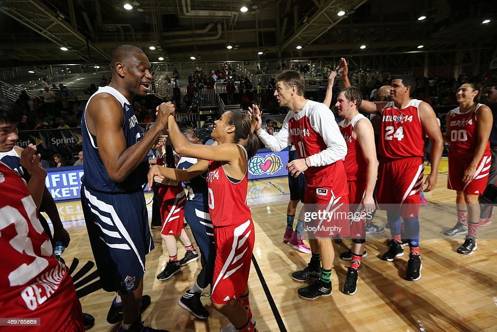 NBA Legend Dikembe Mutombo of the East Team high-fives players of the West Team during the NBA Cares Special Olympics Unified Sports Basketball Game at Sprint Arena during the 2014 NBA All-Star Jam Session at the Ernest N. Morial Convention Center on February 16, 2014 in New Orleans, Louisiana.