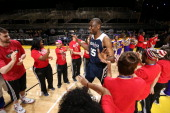 Legend Dikembe Mutombo of the East Team is announced before the NBA Cares Special Olympics Unified Sports Basketball Game at Sprint Arena during the...