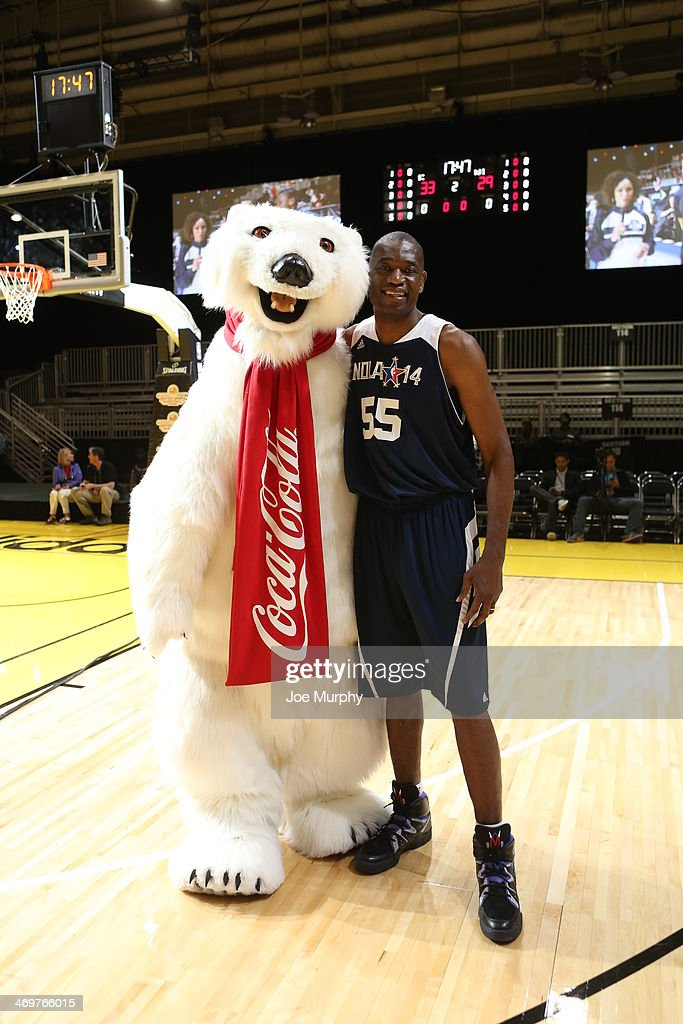 NBA Legend Dikembe Mutombo of the East Team poses for photo with the Coca-Cola Polar Bear during the NBA Cares Special Olympics Unified Sports Basketball Game at Sprint Arena during the 2014 NBA All-Star Jam Session at the Ernest N. Morial Convention Center on February 16, 2014 in New Orleans, Louisiana.
