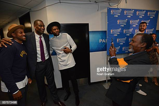 Legend Dikembe Mutombo poses for a photo with Andre Iguodala and Festus Ezeli of the Golden State Warriors after Game Five of the Western Conference...