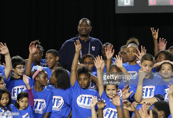 Legend Dikembe Mutombo poses with young NBA and WNBA fans during the Opening Ceremony / NBA AllStar Fit Youth Celebration presented by Exxon Mobile...