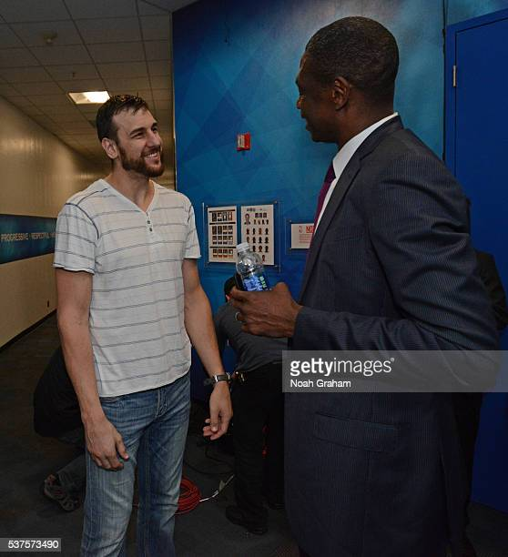 Legend Dikembe Mutombo talks to Andrew Bogut of the Golden State Warriors after Game Five of the Western Conference Finals against the Oklahoma City...