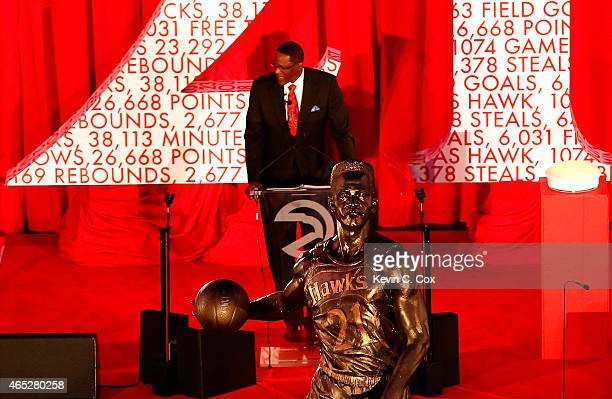 Legend Dominique Wilkins speaks after the Atlanta Hawks honored him with the unveiling of a statue in his name at Philips Arena on March 5 2015 in...