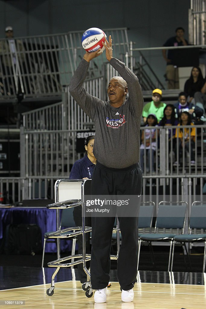 Legend George Gervin shoots the ball during the Legends Shootout on center court at Jam Session presented by Adidas during NBA All Star Weekend at...