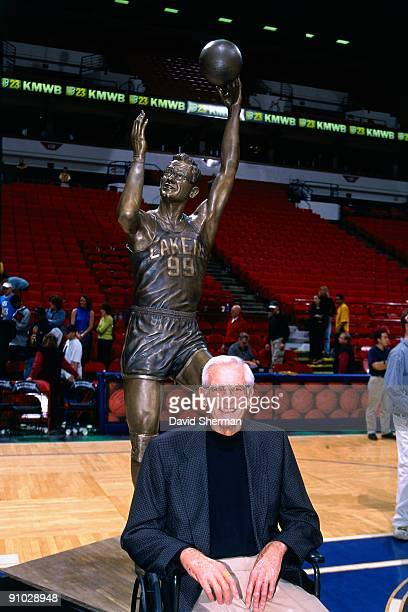 Legend George Mikan stands in front of a statue dedicated to him on April 4 2001 at the Target Center in Minneapolis Minnesota NOTE TO USER User...