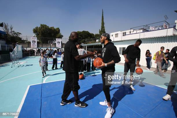 Legend Glen Rice and D'Angelo Russell of the Brooklyn Nets participates during a NBA Cares School refurbishment as part of the NBA Mexico Games 2017...