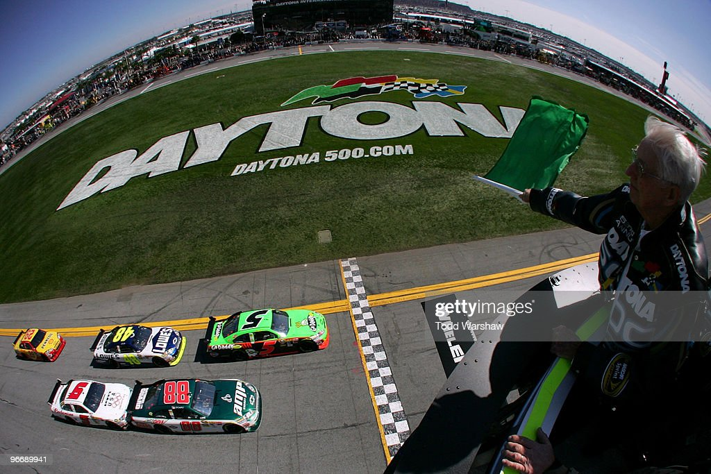 NASCAR legend Glenn Wood waves the green flag as <a gi-track='captionPersonalityLinkClicked' href=/galleries/search?phrase=Mark+Martin&family=editorial&specificpeople=204455 ng-click='$event.stopPropagation()'>Mark Martin</a>, driver of the #5 GoDaddy.com Chevrolet, leads the field to start the NASCAR Sprint Cup Series Daytona 500 at Daytona International Speedway on February 14, 2010 in Daytona Beach, Florida.