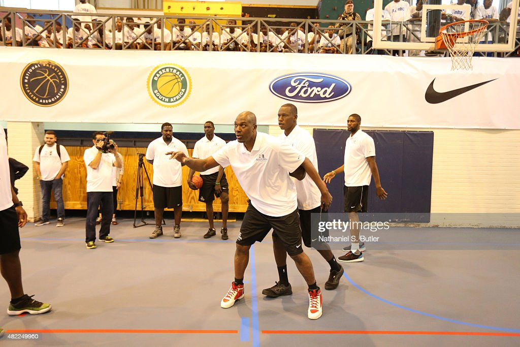 NBA Legend <a gi-track='captionPersonalityLinkClicked' href=/galleries/search?phrase=Hakeem+Olajuwon&family=editorial&specificpeople=202637 ng-click='$event.stopPropagation()'>Hakeem Olajuwon</a> practices with <a gi-track='captionPersonalityLinkClicked' href=/galleries/search?phrase=Gorgui+Dieng&family=editorial&specificpeople=7363274 ng-click='$event.stopPropagation()'>Gorgui Dieng</a> of the Minnesota Timberwolves during the Basketball Without Boarders program on July 28, 2015 at the American International School of Johannesburg in Johannesburg, South Africa.