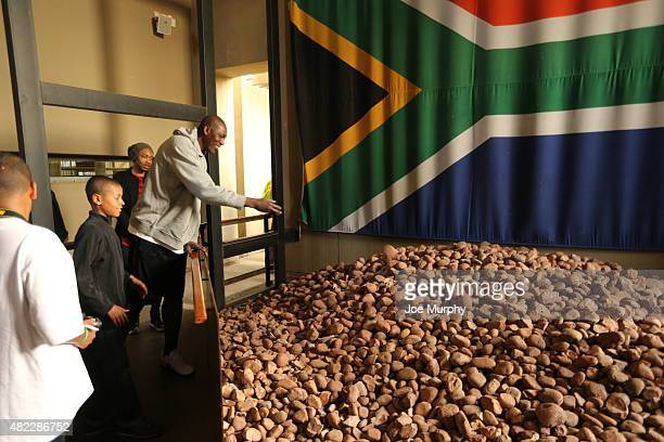 Legend Hakeem Olajuwon takes in the exhibit during the Basketball Without Boarders program on July 28 2015 at the Apartheid Museum in Johannesburg...