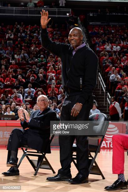 Legend Hakeem Olajuwon waves to the crowd during the Yao Ming jersey retirement ceremony during the Chicago Bulls game against the Houston Rockets on...