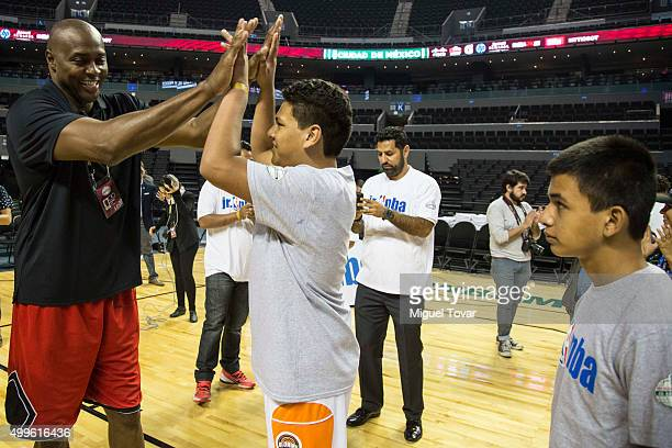 NBA legend Horace Grant greets with a Mexican Special Olympics athlete during the NBA Cares clinic at Arena Ciudad de Mexico on December 02 2015 in...